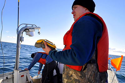 Project lead, Dr. Todd Hayden of Michigan State University, marks a receiver location on a GPS.