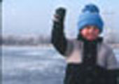 Boy Ice Fishing, with Catch