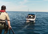 Ontario Provincial Conservation Officer Observing Recreational Vessel