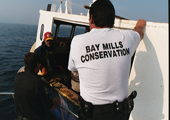 Bay Mills Conservation Officer Inspects Tribal Fishing Vessel